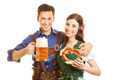 Couple with beer and pretzel at Royalty Free Stock Photography