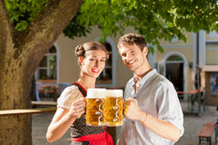 Couple with beer stein and traditional clothes Stock Photography