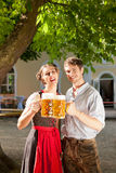Couple with beer stein and traditional clothes Royalty Free Stock Photos