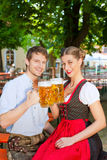 Couple with beer stein and traditional clothes Stock Photos