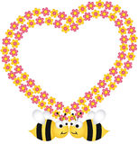 Couple bees with flower heart frame Royalty Free Stock Images