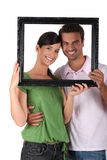 Couple behind black frame Stock Photo