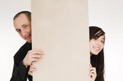 Couple behind board Royalty Free Stock Photo