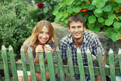 Couple behind the fence Stock Photos