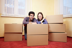 Couple behind moxing boxes Stock Photography