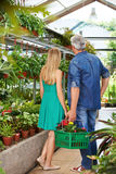 Couple from behind in nursery shop Royalty Free Stock Image