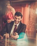 Couple behind poker table Royalty Free Stock Photos