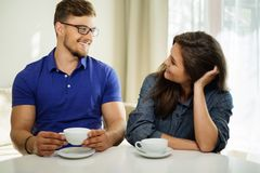 Couple behind table at home Stock Photography