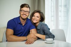 Couple behind table at home Royalty Free Stock Photos