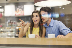 Couple behind window at cafe Royalty Free Stock Photography
