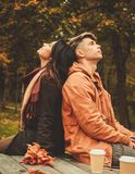 Couple behind wooden table in autumn park Royalty Free Stock Photos