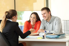 Couple being attended by office worker Stock Photography