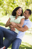 Couple being playful outdoors smiling Royalty Free Stock Image