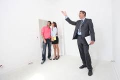 Couple being shown around property Stock Image