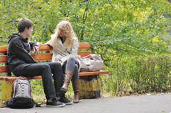 Couple on bench Stock Photography