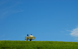Couple on a bench Stock Photography