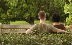 Couple on a Bench. Man and woman close on a park bench stock photos