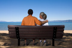 Couple on bench Royalty Free Stock Photos