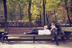 Couple on bench with book Stock Photo