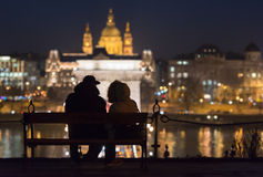 Couple on bench in Budapest, Europe. Stock Photography