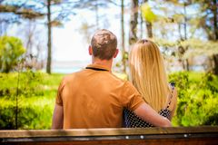 The couple on the bench. The guy with the girl walking along the sea promenade and the Park enjoying nature Stock Image