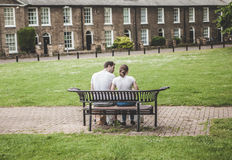 Couple on bench in park Stock Photography