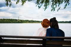 Couple on a bench stock photo