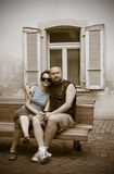 Couple on bench in sepia Stock Images