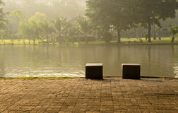 A couple of bench. Two stone benches in the park Royalty Free Stock Photography