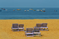 Couple benches on the beach Royalty Free Stock Photography