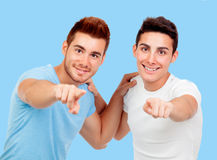 Couple of best friends pointing to the camera Stock Image