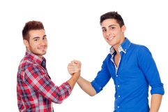 Couple of best friends shaking hands Royalty Free Stock Photos