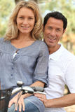 Couple on a bicycle Royalty Free Stock Photo