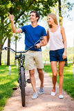 Couple with bicycle. Royalty Free Stock Photo