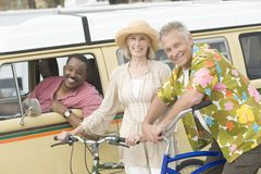 Couple With Bicycle And Friend In RV Stock Image