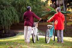Couple with bicycle at park stock images