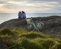 Couple bicycle ride to the ocean royalty free stock images