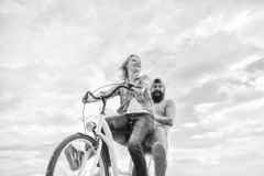 Couple with bicycle romantic date sky background. Psychology of relationships. Leadership in family and marriage. Girl. Controls bicycle handlebar. Couple in stock photography