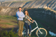Couple with Bicycle Stock Images