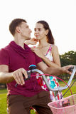 Couple on bicycle a Stock Images