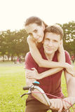 Couple with bicycle a Stock Photos