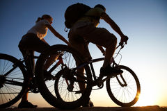 Couple on bicycles Stock Image