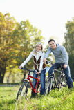Couple on bicycles Royalty Free Stock Photo