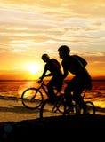Couple on bicycles Stock Photo