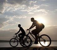 Couple on bicycles. Beautiful Couple on bicycles on the brink of a rock and look afar from rock breakage Stock Images
