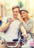 Couple with bicycles in the city Royalty Free Stock Photography