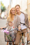 Couple with bicycles in the city Royalty Free Stock Images