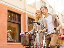 Couple with bicycles in the city Stock Image