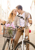 Couple with bicycles in the city Royalty Free Stock Photos