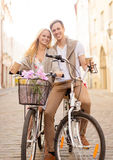 Couple with bicycles in the city Stock Photos